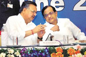 Home truths: P. Chidambaram (right) with Chhattisgarh chief minister Raman Singh in Raipur on Wednesday. PTI