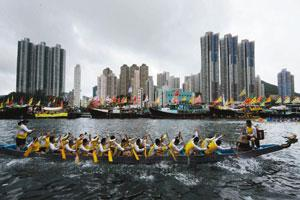 Dance of the dragon: The Dragon Boat races are the highlight of the summer fiesta. Mike Clarke/AFP