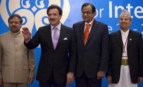 Pakistan's interior minister Rehman Malik waves next to Union home minister P Chidambaram as they pose for a group photo during a Saarc interior ministers meeting in Islamabad on Saturday. Faisal Mahm