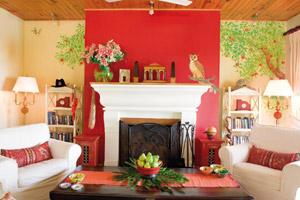 The Gujrals' living room is brought alive with the vibrant red wall on which an owl has been painted, ostensibly to keep a watchful eye on the house. Styled by Ragini Singh