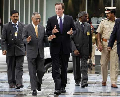 British prime minister David Cameron is being welcomed by Infosys Technologies chairman N R Narayana Murthy at the company's headquarters in Bangalore on Wednesday. Aijaz Rahi / AP photo