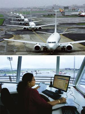 Risk factor: (top) Planes line up for take-off at Delhi airport; an air traffic controller at the Mumbai airport. Of some 80 operational public airports in India, only 23 have undergone a licensing ch