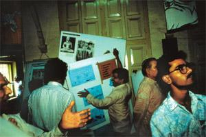 Clampdown: Bajrang Dal activists at Sahmat's 1994 exhibition in Pune.