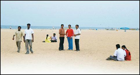 Love rules: ILP workers (standing, from left) Venkatesh, Kishore Kumar and party founder Sri Sri on Marina Beach. Sharp Image
