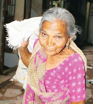 Gold rush: Ganga Gohel, who has been sweeping the streets of Sheth Ni Pol for the past four decades, makes Rs15,000 a month. Mint