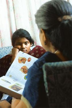 Growing up: Twelve-year-old Ahona gets a lesson in human reproduction from her mother Ajanta. Sarang Sena/Mint