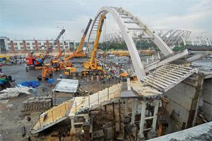 More delays: At least 23 people were injured when the foot overbridge near the Jawaharlal Nehru Stadium collapsed on Tuesday. Ankit Agrawal/Mint