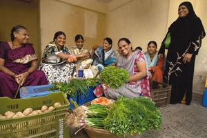 Ray of hope: Alemmunisa (foreground) is one of the women entrepreneurs who launched a vegetable business with help from Jan Sewa. Abhijit Bhatlekar / Mint