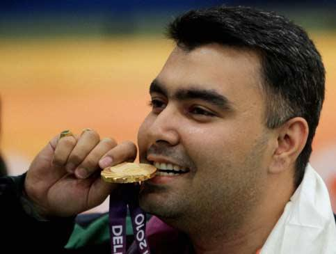 India's ace shooter Gagan Narang celebrates after winning gold in the men's singles 50m rifle 3 position event during the Commonwealth Games at Dr K Singh Shooting Range in New Delhi on Saturday. Manv