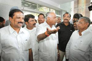Testing times: Karnataka chief minister B.S. Yeddyurappa (centre) with party MLAs at Karnataka Bhavan in New Delhi on Tuesday, a day after he won the vote of confidence in the state assembly amid pand