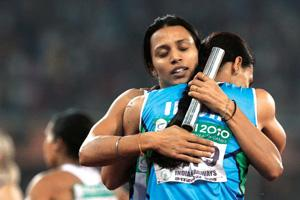 India's Mandeep Kaur, (left) embraces Manjeet Kaur after the team won the women's 4x400m relay gold at Jawaharlal Nehru Stadium. Anja Niedringhaus/AP