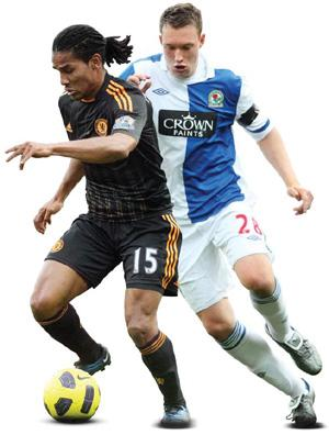 Not the best beginning: Chelsea's Florent Malouda (in black), and Blackburn Rovers' Phil Jones during their English Premier League match in Blackburn on Saturday. Chelsea won 2-1. Photo: AP