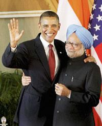 US President Barack Obama and Prime Minister Manmohan Singh greet each other after addressing a joint press conference at Hyderabad House in New Delhi on Monday. Atul Yadav / PTI photo