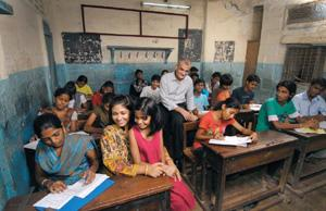 Committed: Rashesh Shah with son Neal (behind him, in a white T-shirt), wife Vidya and daughter Avanti (sitting in her lap) at the Utkarsh Night School in Mumbai. Abhijit Bhatlekar/Mint