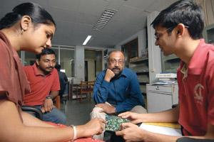 Different approach: Morphing Machines' founder S.K. Nandy (in blue shirt) in the REDEFINE lab at IISc, Bangalore. Hemant Mishra/Mint