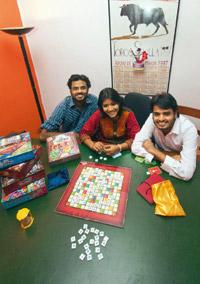 Wordplay: (from left) Rajat Dhariwal, Madhumita Haldar and Manuj Dhariwal with a game of Aksharit. Aniruddha Chowdhury / Mint