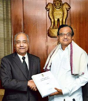Sealed and delivered: Former Supreme Court judge B.N. Srikrishna (left) hands over the report to home minister P. Chidambaram on Thursday. Kamal Kishore/PTI