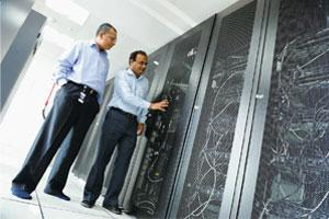 Creating infrastructure: Sanat Jethova (left), senior consultant at TCS, inspecting a server room. Vijay Somesh/Mint