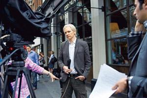 The trial: WikiLeaks founder Julian Assange outside the Frontline Club in London. Andrew Testa/The New York Times