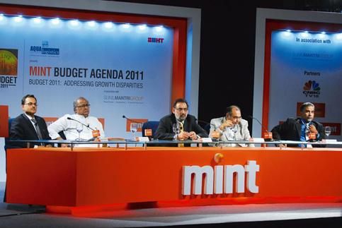 Debating growth: (Left to right) Hemant Kanoria, chairman and managing director, Srei Infrastructure Finance Ltd; Saugata Roy, Union state minister for urban development; Haseeb Drabu, former chairman
