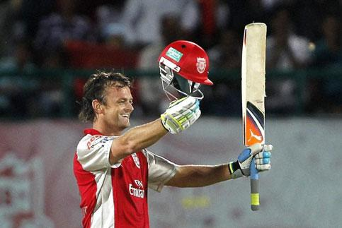 Kings XI Punjab's Adam Gilchrist celebrates his century against Royal Challengers Bangalore in Dharamsala on Tuesday. PTI Photo