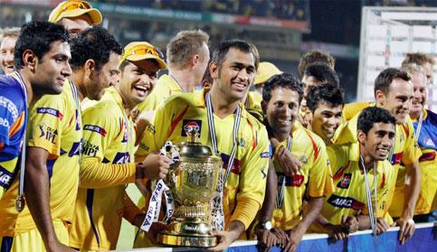 Chennai Super Kings captain M. S. Dhoni along with the team players celebrates with the IPL 4 trophy in Chennai on Saturday. PTI Photo