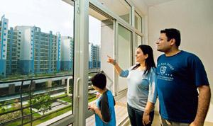 Deepak Narangs wife looking at a multi story bulding in Noida. These are newly built residential properties,offers most of the facilities like club, park and small shopping arcade. Ramesh Pathania/Min