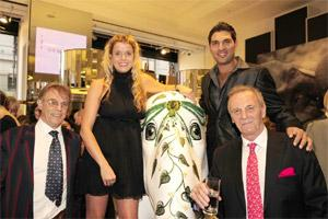 Cricketer Yuvraj Singh with the 'Emerald Queen' at the Emeralds for Elephants event in London in June 2010.