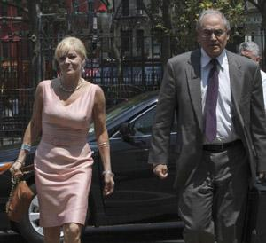 Danielle Chiesi, left, arrives at Manhattan Federal court with her attorney Alan Kaufman Wednesday, 20 July , 2011 in New York