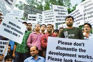 Uncertain future: Homebuyers who have invested in projects at Noida Extension protest in Noida on Saturday. Photograph by Gajendara Yadav/HT