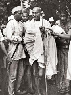 Setting an example: Mahatma Gandhi believed that no matter how much work one has, one should always find time to go for a walk. Photo by Fox Photos/Getty Images