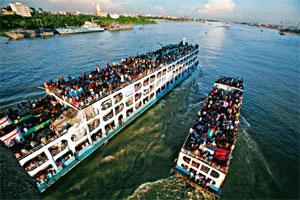 Ferrying across: Bangladeshi migrant workers heading home to Dhaka for Eid, across the Buriganga river, last month. Photographs by Pavel Rahman/AP