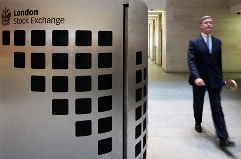 A visitor passes through the atrium of the London Stock Exchange Group Plc in London. Photo: Bloomberg