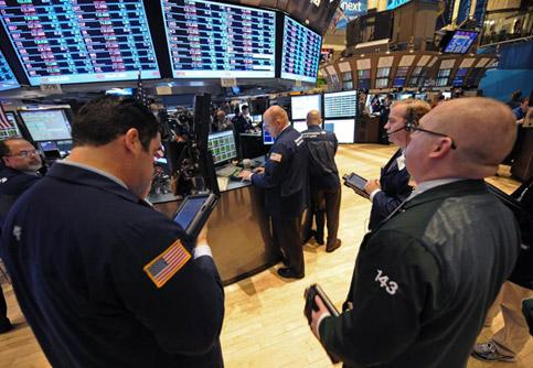 File photo of traders working on the floor of the New York Stock Exchange, in New York.AP Photo.