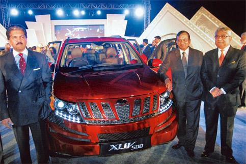 Export focus: Anand Mahindra (left) with other company officials at the launch of the XUV500 in Pune on Thursday. (Photo PTI)