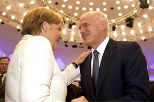 Angela Merkel, Germany's chancellor, left, shakes hands with George Papandreou, Greece's Prime Minister. Photo: Bloomberg
