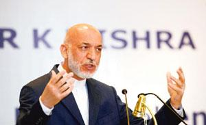 Future manoeuvres: Hamid Karzai said his efforts in bringing peace to Afghanistan will now be focused on talking to the Pakistan government. By Gurinder Osan/AP