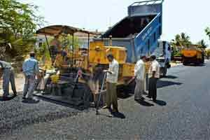 Money matters: A file photo of an under-construction road in Warangal, Andhra Pradesh