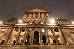 The Bank of England is seen illuminated at night in London. (file photo Bloomberg)