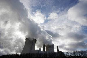 Smokestacks and cooling towers emit smoke and water vapour. Photo: Bloomberg