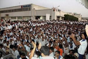 Workers shout slogans as they sit on strike on 7 October 2011 at Suzuki's Motor Corp's Manesar plant in Haryana. Photo by PTI.