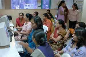 A file photo of a group of women at a technology awareness class