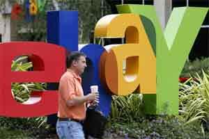 A man passes an eBay sign outside the company's headquarters in California. Photo: Bloomberg