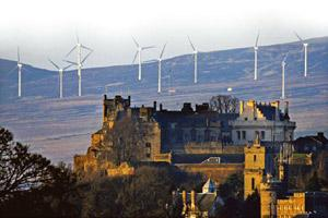 Crossroads of time: Wind turbines overlook the ancient Stirling Castle perched atop Stirling, the gateway to Scotland. Photo by Jeff J Mitchell/Getty Images.