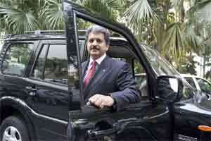 A file photo of Anand Mahindra,vice chairman & managing director, Mahindra & Mahindra Limited with a Mahindra Scorpio SUV in the background