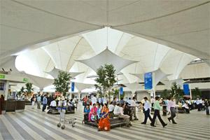 Equity transfer: A file photo of the Mumbai international airport. GVK Power expects the Mumbai and Bangalore airports together to account for passenger traffic of around 43 million for fiscal 2012. H