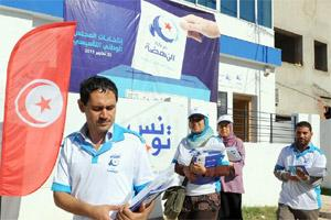 Tunisians distribute electoral leaflets in Ariana. AFP