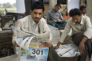 File photo of people reading the hindi daily Hindustan from HMVL.