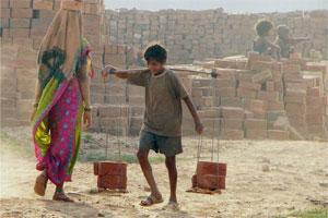 A child labour works at a brick factory in Allahabad. Photo: PTI.