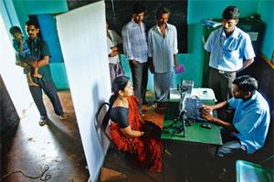 Building a database: Residents being enrolled under the UID project in Tumkur, Karnataka. Photo: Hemant Mishra/Mint.